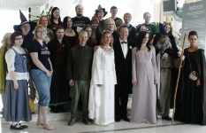 Soprano Kaitlyn Lusk and Erik Ochsner pose for a group photo with members of the Finish Tolkien Society in Tampere, Finland.